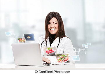 Female nutritionist - conceptual photo of a female ...