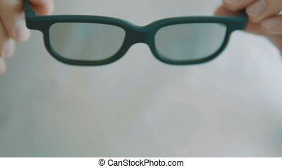 Female oculist doctor hands giving pair of optometry glasses...