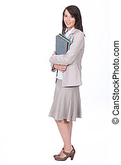 Female office worker carrying folders