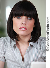 Female office worker with a bobbed haircut