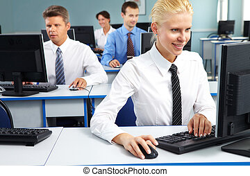 Female office worker - Young office worker sitting at...