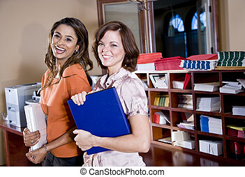 Female office workers in copy room
