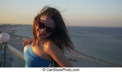 Female on a rooftop with a sea view