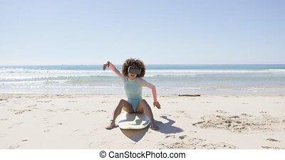 Female on beach wearing virtual reality glasses - Female on...