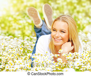 Female on chamomile field