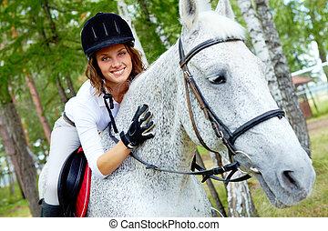 Female on horse - Image of happy female jockey on purebred...