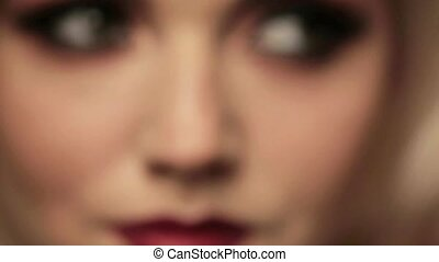 Female open eyes with evening makeup, close-up. Bright...
