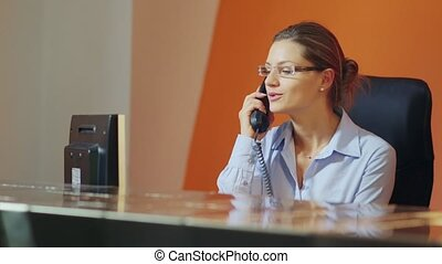 female operator in hotel reception - Female teenager working...