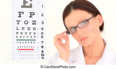 Female ophthalmologist posing against a white background