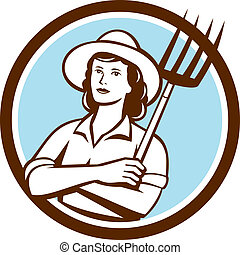 Illustration of a female organic farmer with pitchfork with hat facing front set inside circle on isolated bakcground done in retro style.