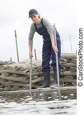 female oyster farm worker