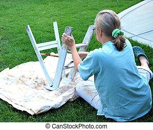 Female painting.