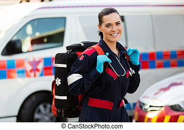 female paramedic carrying lifepack - beautiful young female...