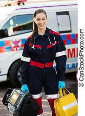female paramedic holding portrable devices - attractive...