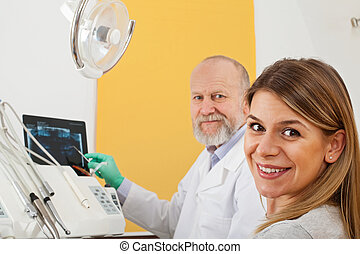 Female patient at the dentist office