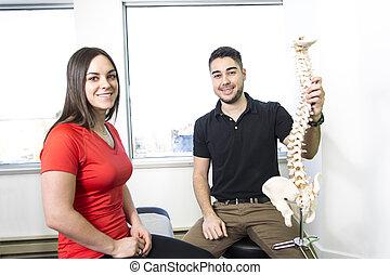 Female Patient Describing talk to Injury  Osteopath