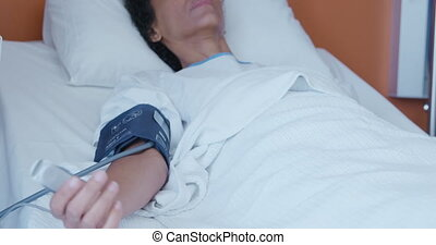 Female patient in a hospital bed