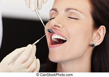 Female Patient Receiving Treatment From Dentist