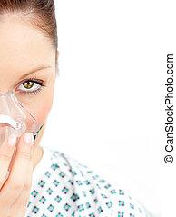 female patient with an oxygen mask portrait against a white ...