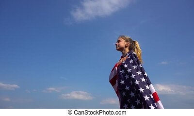 Female patriotic with USA flag in nature - Side view of...