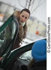 pedestrian argues with car driver