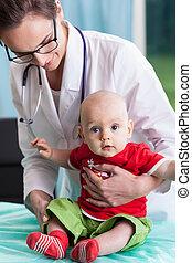 Female pediatrician with little boy