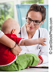 Female pediatrician with little patient