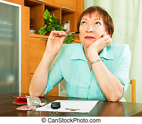 Female pensioner doing financial work indoor