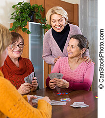 Female pensioners playing cards