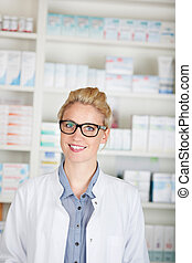 Female Pharmacist At Drugstore