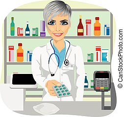 female pharmacist giving pills in blister pack standing in a...