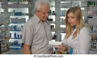 Female pharmacist tells customer about the medicine