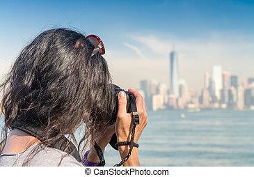 Female photographer capturing New York skyline