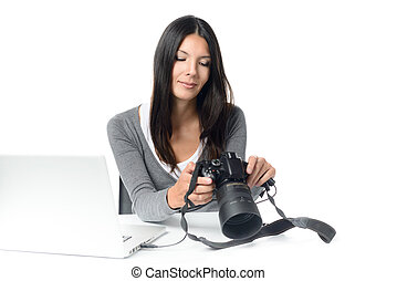 Female photographer checking an image on a camera