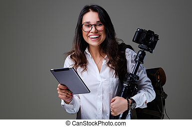 Female photographer holds tripod and tablet PC.