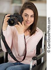 female photographer in a wheelchair