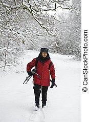 Female photographer in snow