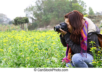 Female photographer on field