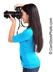 Female Photographer Shooting Someone or Something - A female...