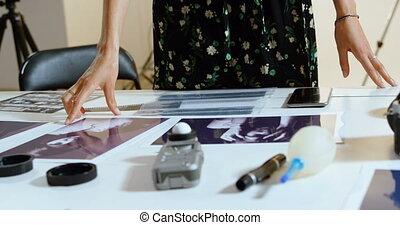 Female photographer standing at desk 4k - Female...