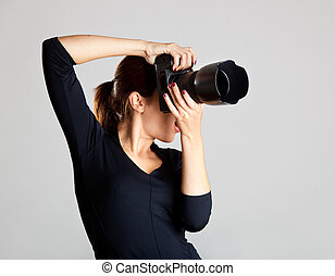 Female Photographer - Portrait of a beautiful and attractive...
