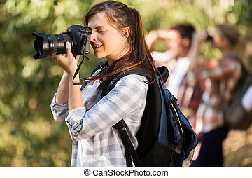 female photographer taking pictures in nature