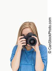 Female photographer with photographic camera