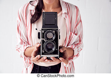 Female Photographer With Vintage Medium Format Camera On ...