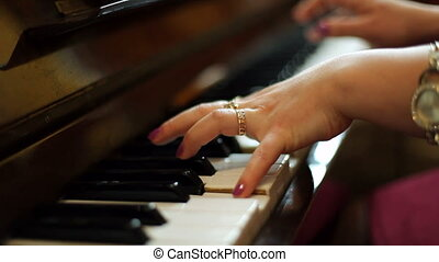 Female pianist - A woman plays the piano.