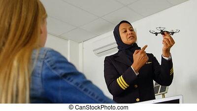 Female pilot about model drone to kid 4k - Female pilot...