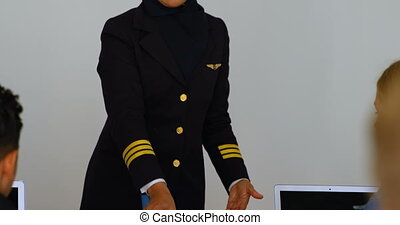 Female pilot about model plane to kids 4k - Female pilot...