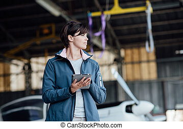 Female pilot using a digital tablet