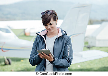 Female pilot using a tablet