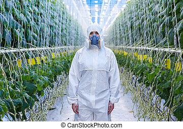 Female Plantation Worker in Hazmat Suit